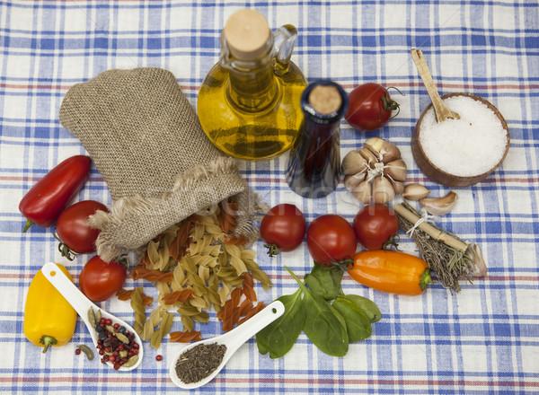 Stock photo: Fusilli Italian pasta set for the creation : cherry tomatoes, olive oil, balsamic sauce, garlic, spi
