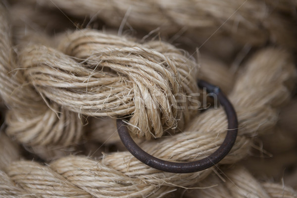 Coil of rope with a marine unit, and an iron ring. Stock photo © mcherevan