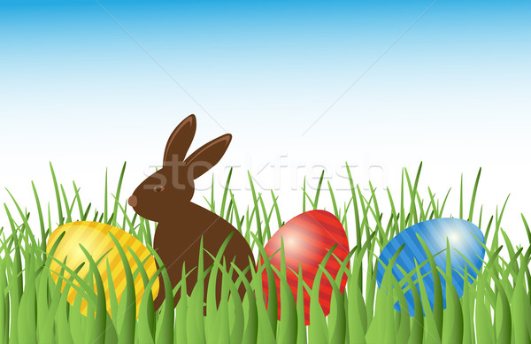 Chocolate bunny with easter eggs in grass. Vector. Stock photo © mcherevan