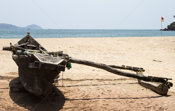 Stock photo: Old fishing boat standing on the sandy beach. India, Goa