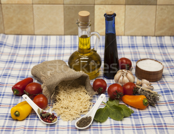 Stock photo: Vermicelli Italian pasta set for the creation : cherry tomatoes, olive oil, balsamic sauce, garlic,