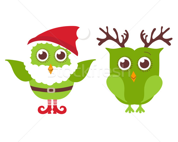 Two cute Christmas owls. One owl in Santa hat and beard and one in reindeer horns. Stock photo © mcherevan