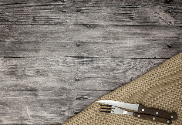 Stock photo: Beautiful wooden background with napkin knife and fork. Fine background for the menu of restaurants
