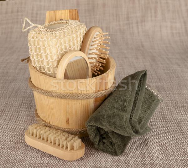Small wooden spa set, sponge, pumice stone, a mirror, towel, brush, comb Stock photo © mcherevan