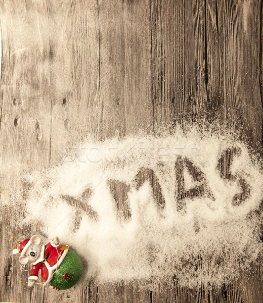Christmas card with the inscription xmas with christmas toys in the snow on a wooden background Stock photo © mcherevan