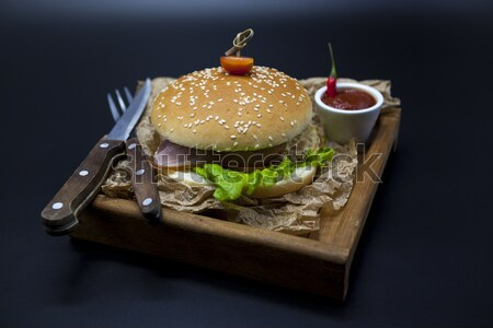 Black burger. A burger with a black roll slices of juicy marble beef, fused cheese, fresh salad and  Stock photo © mcherevan