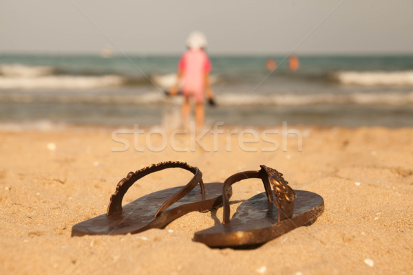 a06a3bb35  6092676 Flip-flop on sand beach of Lake Balaton by mcherevan Stock photo