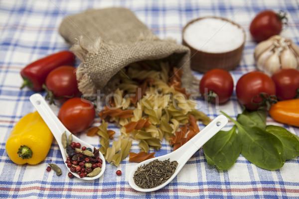 Fusilli Italian pasta set for the creation : cherry tomatoes, olive oil, balsamic sauce, garlic, spi Stock photo © mcherevan