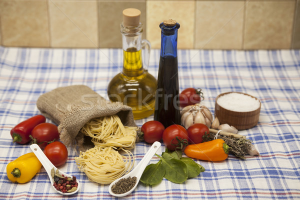 Tagliatelle Italian pasta set for the creation : cherry tomatoes, olive oil, balsamic sauce, garlic Stock photo © mcherevan
