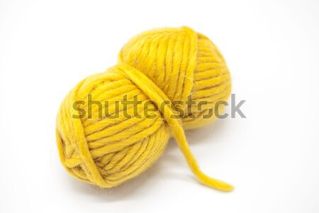 Yellow ball of wool yarn for knitting close up on a white background. Stock photo © mcherevan