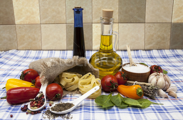 Beautiful set for the creation of the Sicilian pasta: cherry tomatoes, olive oil, balsamic sauce, ga Stock photo © mcherevan