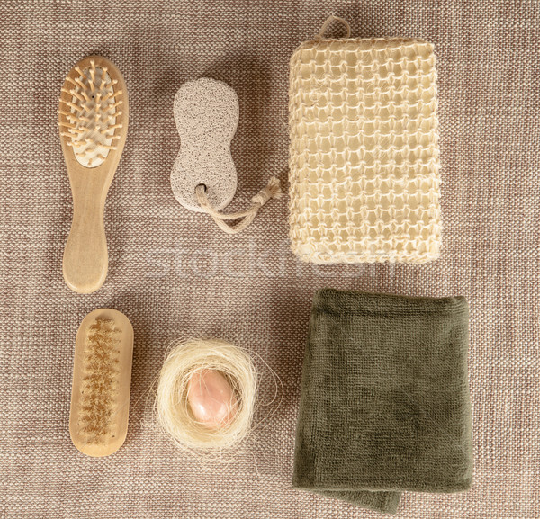 Small wooden spa set, sponge, pumice stone, a mirror, towel, brush, comb Stock photo © mcherevan
