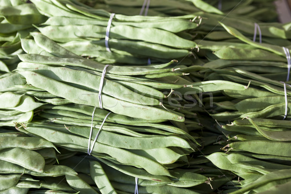 Bundles of fresh green beans . Green beans, Hanging haricot bean, Phaseolus vulgaris pods alone. Clu Stock photo © mcherevan