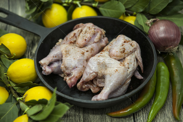 Two raw fresh chicken on porcelain plate with lemon and chilli  on the wooden background Stock photo © mcherevan