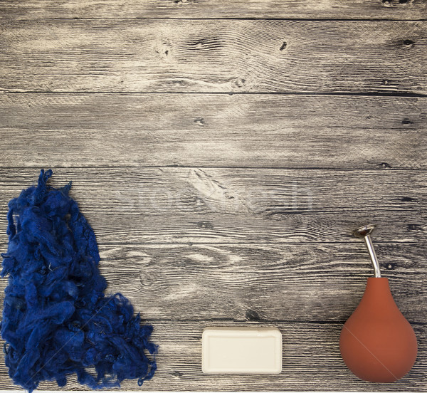 Excellent mocap  with blue wool, soap, orange watering felting on a wooden background Stock photo © mcherevan