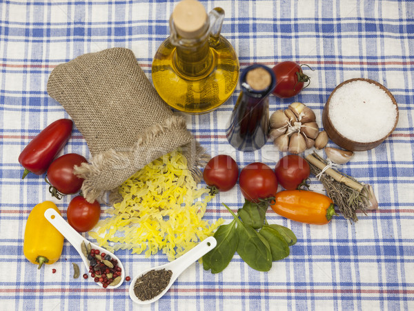 Stock photo: Gemelli Italian pasta gluten-Free  set for the creation : cherry tomatoes, olive oil, balsamic sauce