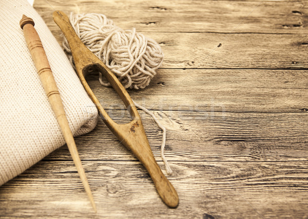Excellent mocap two old wooden spindle with a ball of wool thread for the manufacture of woolen thre Stock photo © mcherevan