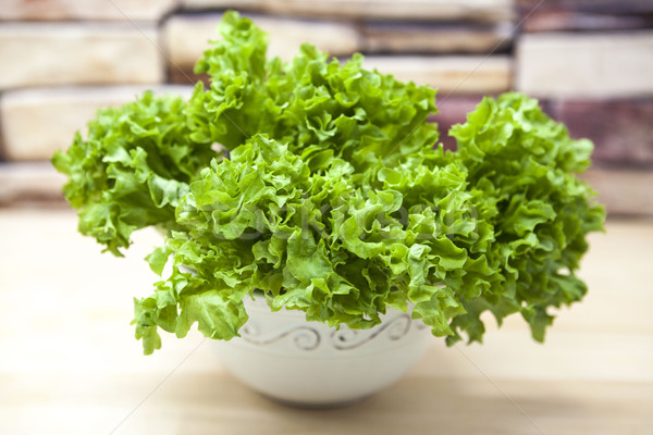 Green new linking of salad in a pot on a wooden background in country kitchen. The best healthy brea Stock photo © mcherevan