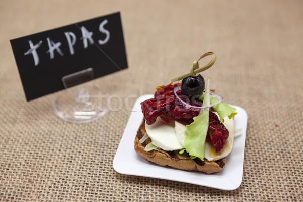 Finom spanyol tapas rusztikus mozzarella szárított paradicsom Stock fotó © mcherevan