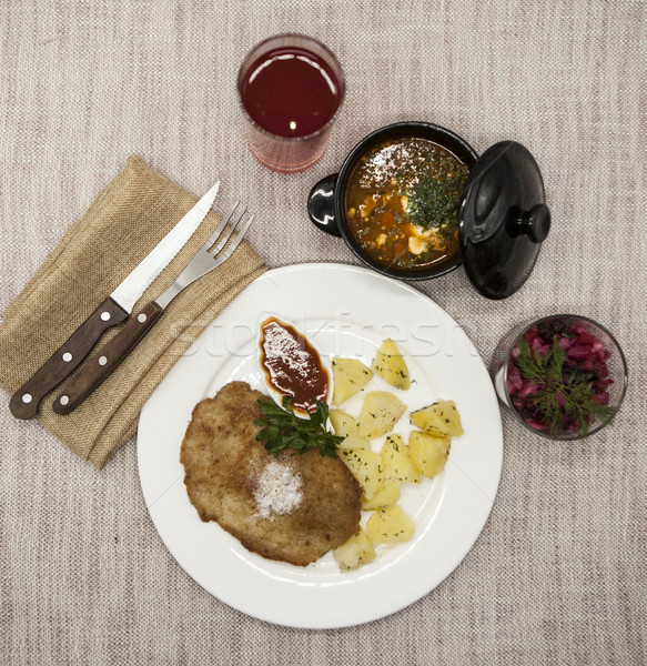 Stock photo: Business lunch : Petite Wiener schnitzel with boiled potatoes and ketchup. Served on a white porcela