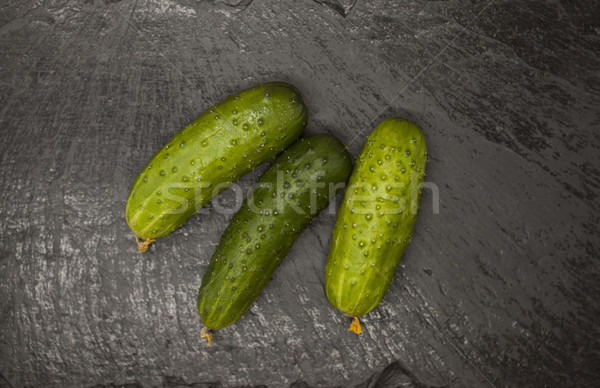Fresh appetizing tasty cucumber on a stone background. Stock photo © mcherevan