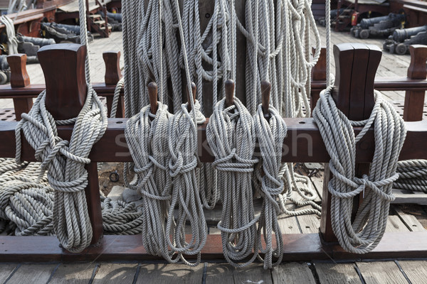 Older intricate marine ropes closeup on a ship deck. Stock photo © mcherevan