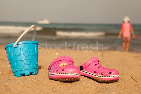 1a32a034e  6092674 Flip-flop on sand beach of Lake Balaton by mcherevan Stock photo