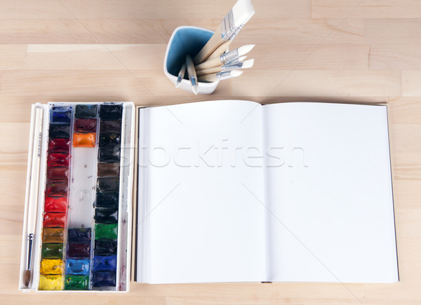 Beautiful composition of watercolor paints and brushes, album artist Stock photo © mcherevan