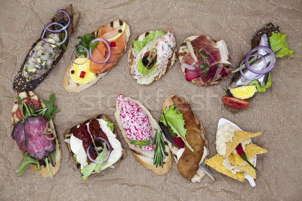 Set of Spanish tapas on the textiles background . Great background for restaurant, cafe Stock photo © mcherevan
