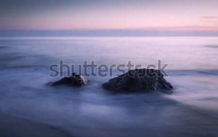 Iki kayalar akşam karanlığı sığ alan uzun pozlama Stok fotoğraf © mdfiles