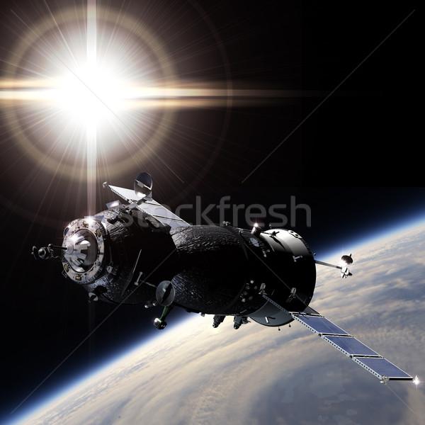 Spaceship on the orbit Stock photo © mechanik
