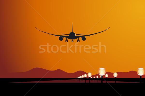 Repülőgép leszállás naplemente égbolt narancs utazás Stock fotó © mechanik
