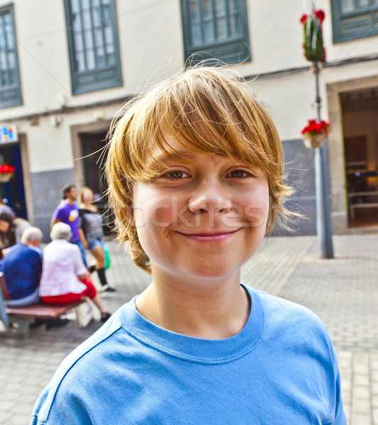 smart boy enjoys walking in the pedestrian zone  Stock photo © meinzahn
