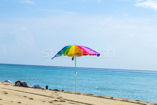 Ombrellone colorato sabbia spiaggia cielo sole Foto d'archivio © meinzahn