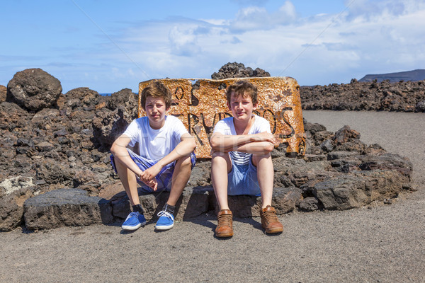 brothers sitting on a rock and have a rest  Stock photo © meinzahn