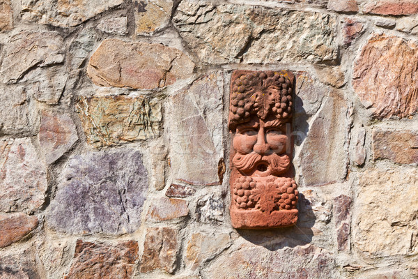Eski ortaçağ taş duvar yüz Tanrı şaraphane Stok fotoğraf © meinzahn