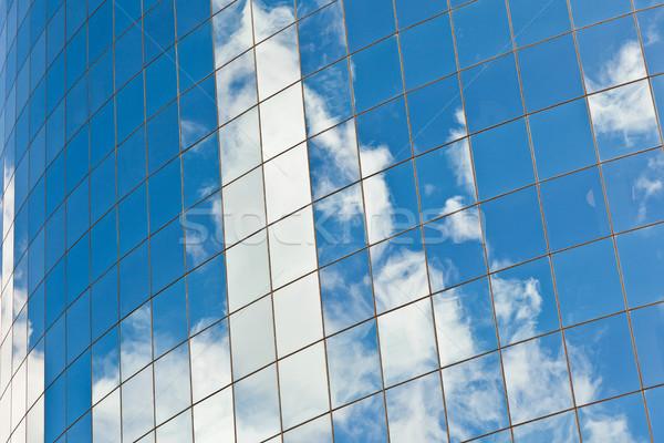 facade of Skyscraper with reflection of sky Stock photo © meinzahn