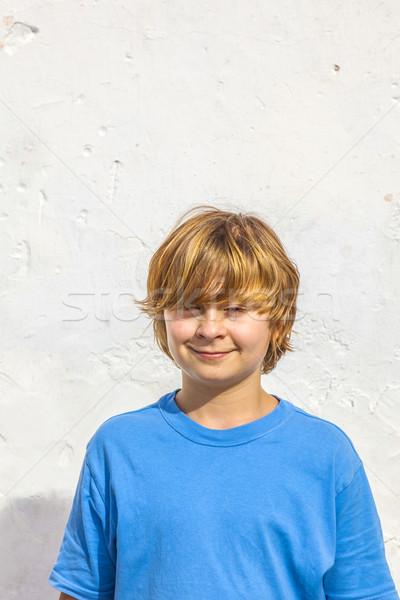 Portret cute młody chłopak światło słoneczne biały ściany Zdjęcia stock © meinzahn