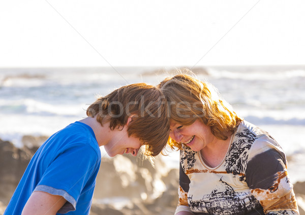 mother and son enjoy the afternoon sun at the beach Stock photo © meinzahn