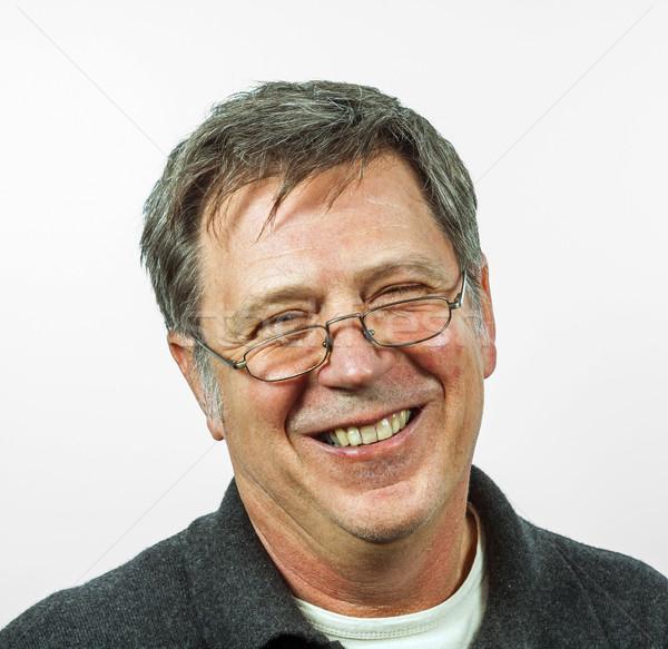 Glimlachend man geïsoleerd witte gezicht ogen Stockfoto © meinzahn