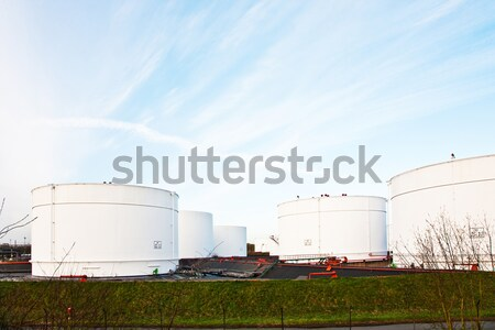 Stock photo: white tanks for petrol and oil in tank farm with blue sky