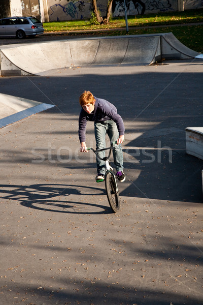 joung red haired boy jumps with his BMX Bike at the skate park  Stock photo © meinzahn