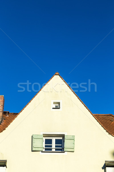 family home in suburban area with blue sky
