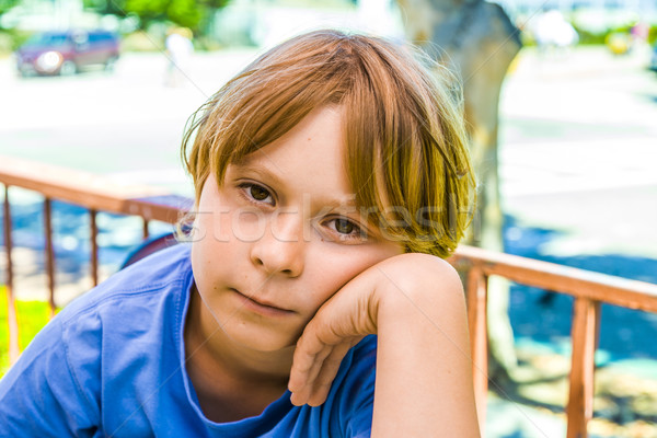 boy with brown hair is looking displeased Stock photo © meinzahn
