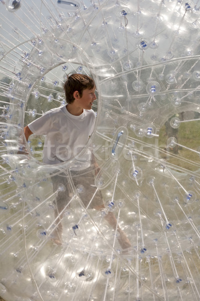 child has a lot of fun in the Zorbing Ball Stock photo © meinzahn
