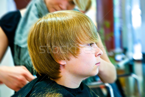 smiling young boy  at the hairdresser Stock photo © meinzahn