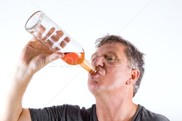 Man drinken alcohol uit fles oranje Stockfoto © meinzahn
