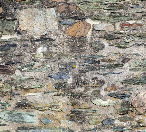 Wall built of rough natural stones in various sizes  Stock photo © meinzahn