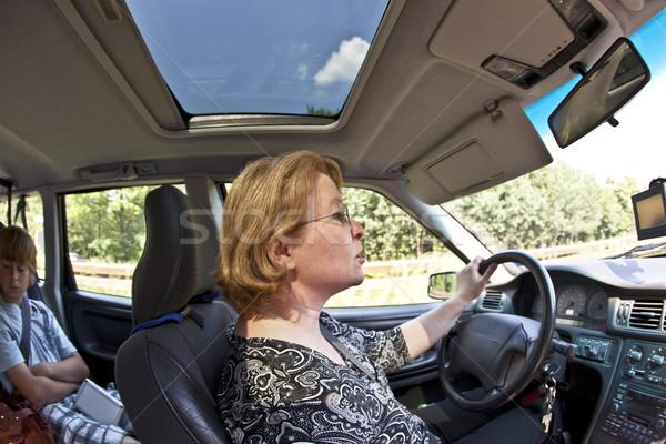 woman  is driving car  Stock photo © meinzahn