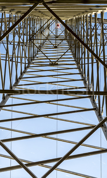 high voltage electricity pylons against blue sky and cloud  Stock photo © meinzahn